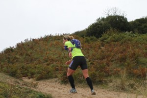 Michelle Maxwell running up a sand dune