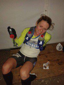 Michelle holding her finishing medal