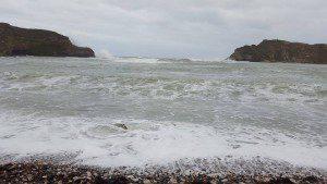 Lulworth Cove, waves crashing on beach