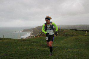 Michelle running on the Jurassic coast path