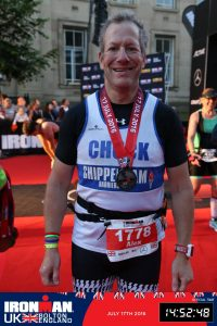 Alex Ralton with finishers medal Ironman UK