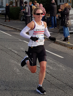 Woman representing England in a road race