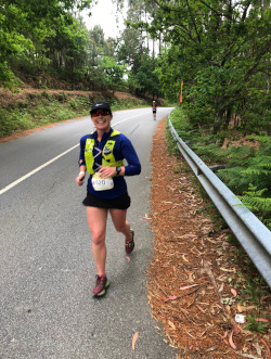 A runner running a road race in the woods